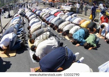 Prayer of Arabs in Damascus gates in Jerusalem. - stock photo