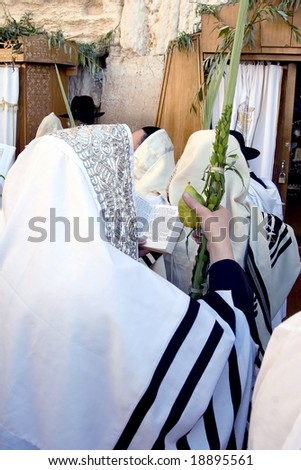 Prayer of Jew in western wall in Jerusalem on the holiday Of sukkot. - stock photo