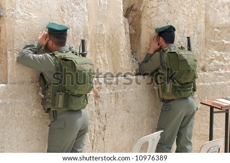 Prayer of soldiers in the western wall. - stock photo