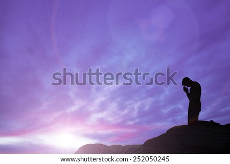 prayer on mountain top - stock photo