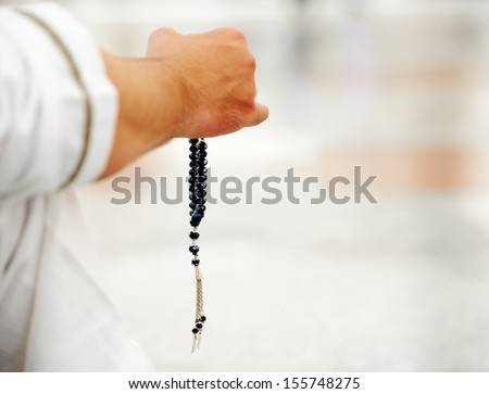 Prayer using rosary - stock photo