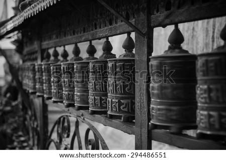Prayer wheels at Swayambhunath temple in Kathmandu Nepal - stock photo