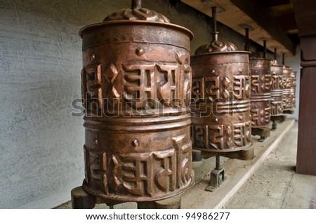 prayer wheels in Nepal - stock photo