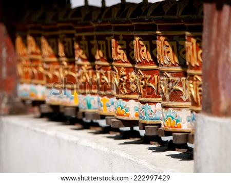 Prayer wheels in Sikkim, India for good karma - stock photo