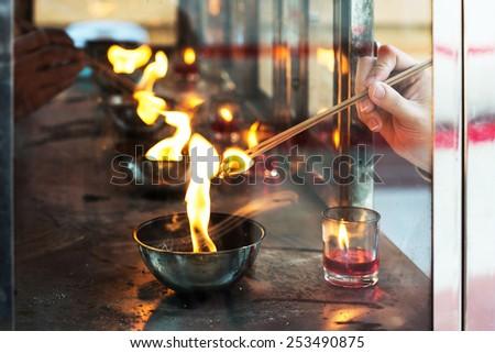 Prayers burning incense sticks - stock photo