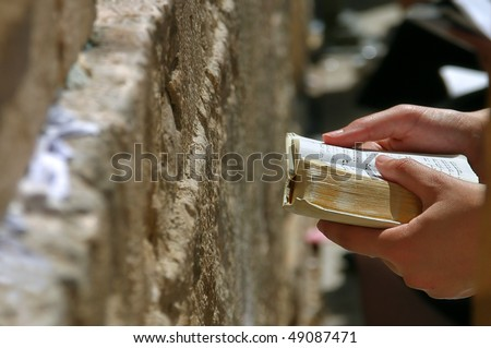 Prayers hands with Torah Book during prayer at Western Wall in Jerusalem, Israel. - stock photo