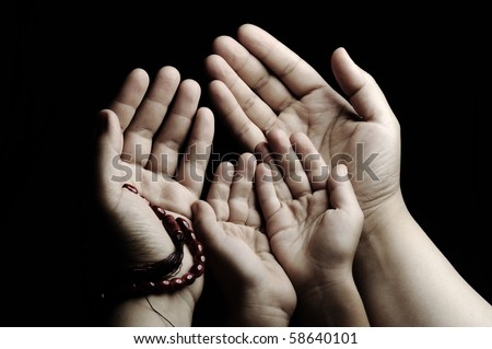 Praying and teaching, child and adult praying together - stock photo