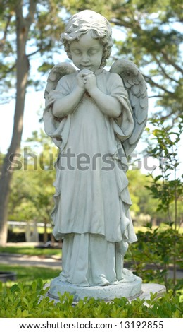 Praying angel child statue at Our Lady of La Leche in St. Augustine, Florida. - stock photo