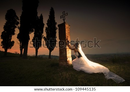 Praying bride - stock photo