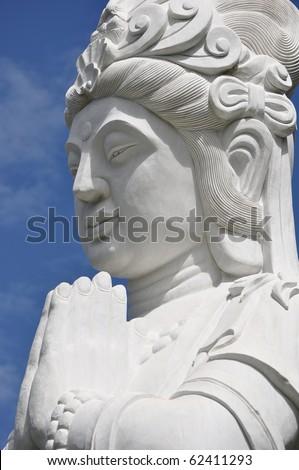 Praying Buddah - stock photo