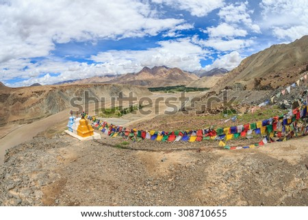 Praying flags and three stupas at Confluence of the Indus and Zanskar Rivers, leh, ladakh, india