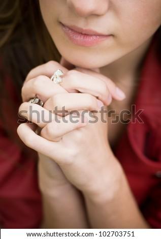 Praying hands: Closeup shot of a beautiful young woman hands in prayer - stock photo