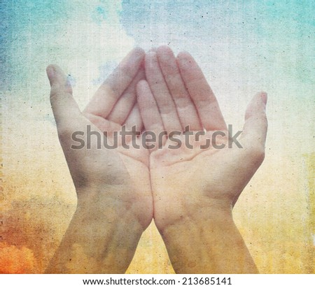 Praying Hands on vintage background. - stock photo