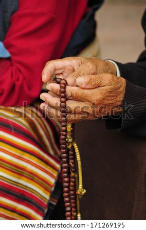 praying in Buddhist temple 4 - stock photo