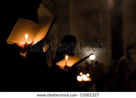 Praying in church - abstract - stock photo