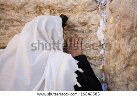 Praying Jew on Jerusalem Western wall during sabbath. - stock photo