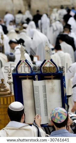 Praying Jewish with Torah scroll at Passover - stock photo