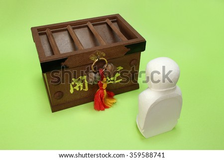 "praying ksitigarbha and the offertory box in the green Note: Japanese word of this photo means ""better fortune"" - stock photo"