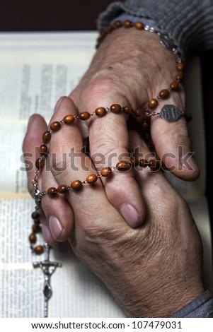 praying old man hands - stock photo