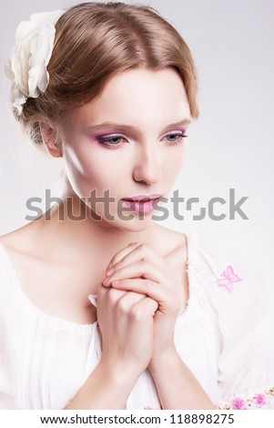 Praying sensual woman. Despair and hopelessness - stock photo
