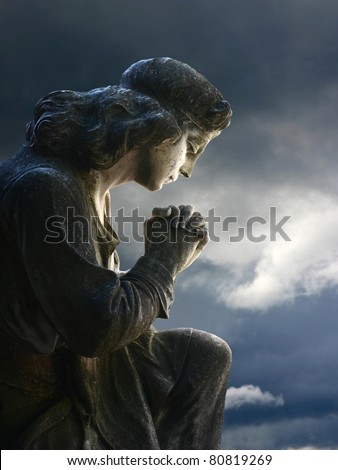 praying statue - stock photo