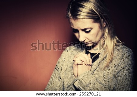Praying woman. - stock photo