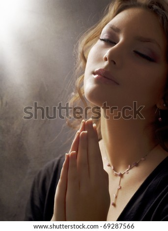 Praying Woman.Retro Styled.Soft focus - stock photo