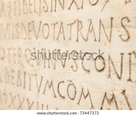 Pre-christian latin writing carved on the tombstone - stock photo