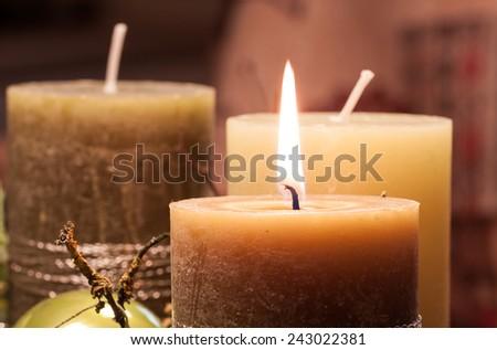 Pre-Christmas Time - Christmas wreath with candle-lit Christmas tree balls for decoration - stock photo