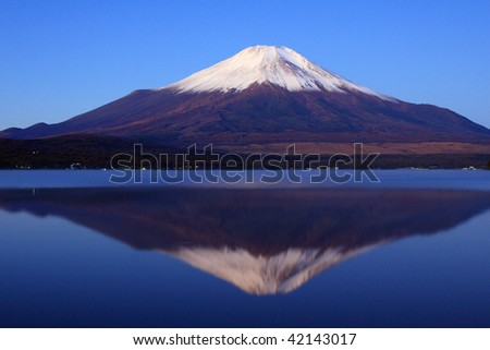 Pre-dawn view of Mount Fuji with mirror reflection in lake - stock photo