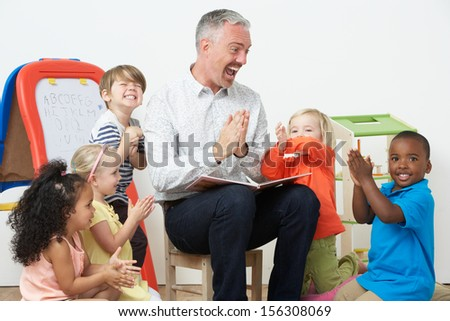 Pre School Teacher Reading Story To Children And Praying - stock photo