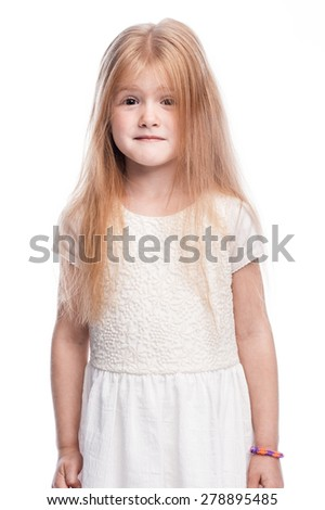 Pre-school toddler girl posing for a portrait. Shot in the studio on a white background. - stock photo