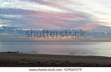 Pre-sunrise twilight on a winter day over the Moreton Bay, Queensland, Australia - stock photo