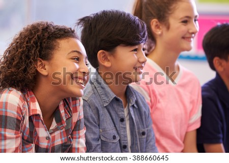 Pre-teen elementary school kids in a lesson - stock photo