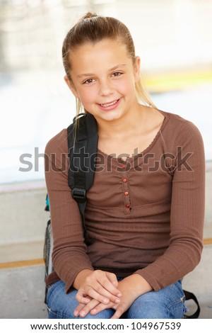 Pre teen girl in school - stock photo