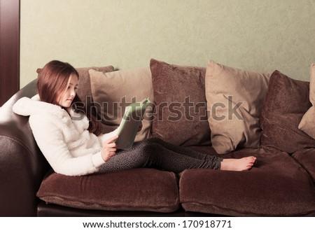 pre-teen girl reading a book - stock photo