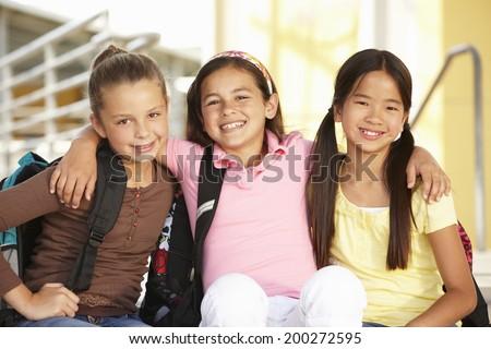 Pre teen girls in school - stock photo