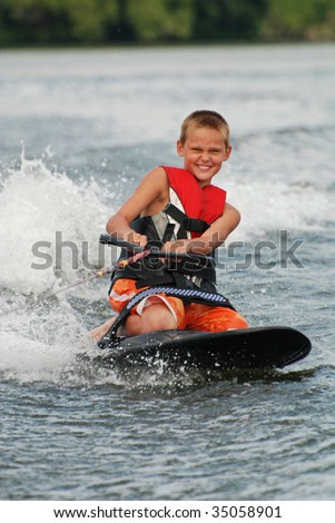 pre-teen on knee board - stock photo