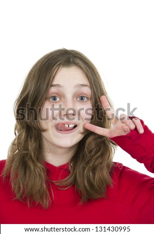 Pre teen young girl sticking her tongue out on white background - stock photo