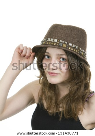 Pre teen young girl wearing a brown hat on white background - stock photo