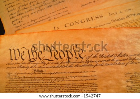 Preamble to the Bill of Rights and the Declaration of independence in the background - stock photo