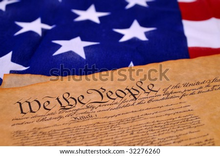 Preamble to the US Constitution with the stars and stripes in the background - stock photo