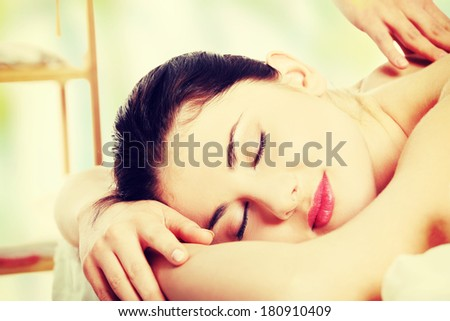Preaty young woman relaxing beeing massaged in spa saloon  - stock photo