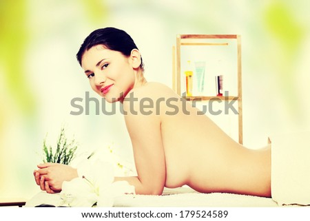 Preaty young woman relaxing in spa saloon  - stock photo