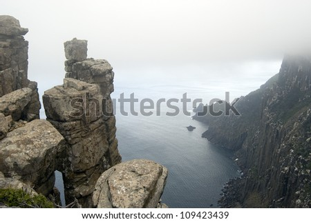 Precarious stacks of dolerite form the rugged cliffs of Cape Pillar, Tasmania - stock photo