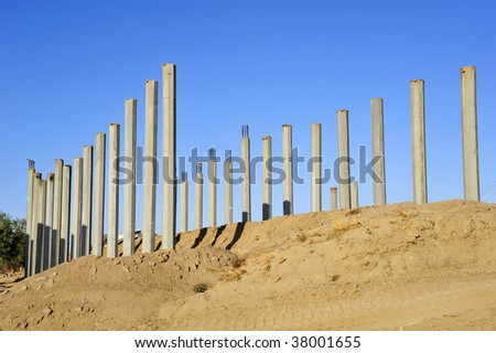 Precast concrete pilings are installed in river bottom to support new bridge - stock photo