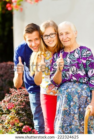 Precious loving family members showing thumbs up.