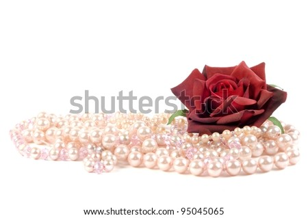 Precious pearls beads with red rose,  micro shot - stock photo