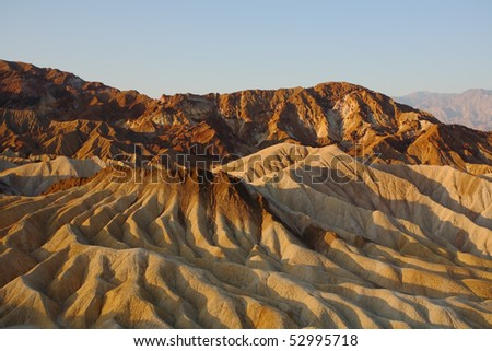 Precise mountain folds well-known a Zabrisky-point in Death valley in the USA. A sunset - stock photo