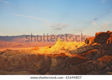 Precise mountain folds well-known  Zabriskie-point in Death valley in the USA. A sunset - stock photo